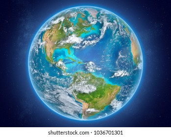 Puerto Rico in red on model of planet Earth with clouds and atmosphere in space. 3D illustration. Elements of this image furnished by NASA.