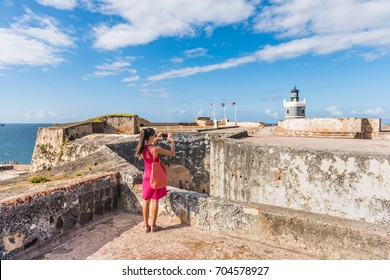 Puerto Rico travel tourist woman in San Juan, at the fort Castillo San Felipe Del Morro, famous attraction of Old San Juan city in Puerto Rico, USA. Summer holidays.