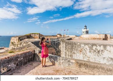 Puerto Rico travel tourist woman in San Juan, at the fort Castillo San Felipe Del Morro, famous attraction of Old San Juan city in Puerto Rico, USA. Summer holidays.