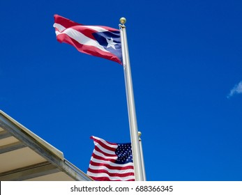 Puerto Rico & United States Flag under a Blue Sky