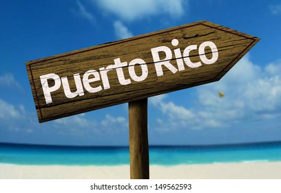 Puerto Rico wooden sign with a beach on background