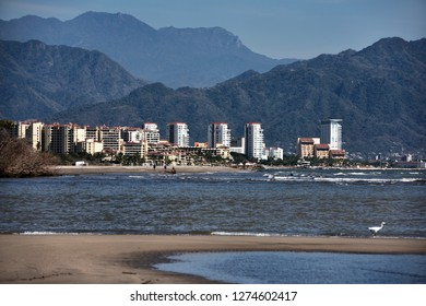 Puerto Vallarta highrise hotels from sandbank on Banderas Bay with Sierra Madre mountains