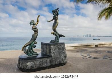 Puerto Vallarta, Jalisco/ Mexico - 05/04/2015: Bronze sculpture by Carlos Espino focusing on beauty of human form on artwalk along Malecon, waterfront esplanade.