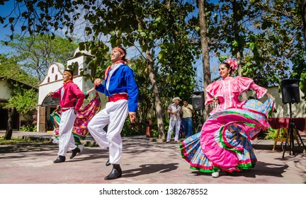Puerto Vallarta, Jalisco/ Mexico - 05/06/2015: Trio- two men and one woman- in traditional dress perforing folkloric dances in Puerto Vallarta, Mexico.