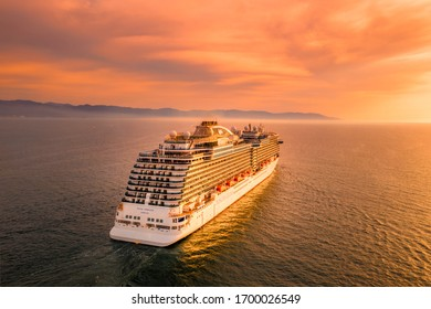 Puerto Vallarta, Jalisco / Mexico - 27/03/19 Princess Cruises heading back home with the most spectacular sunset as a background.