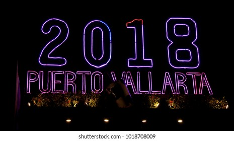 Puerto Vallarta, Jalisco/Mexico - February 2, 2018 :   2018 Puerto Vallarta lit up sign on Malecon Boardwalk