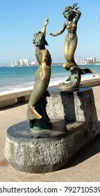 Puerto Vallarta, Jalisco/Mexico = January 12, 2018:  Bronze Mermaid and Merman statue at Malecon Boardwalk in PV