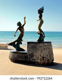 Puerto Vallarta, Jalisco/Mexico = January 12, 2018:  Mermaid and Merman bronze statue in Malecon Boardwalk, PV