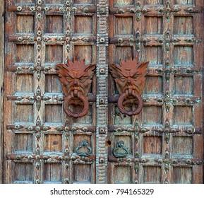 Puerto Vallarta, Jalisco/Mexico - January 12, 2018:  Rusted Gargoyle Door Knockers
