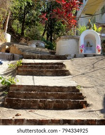 Puerto Vallarta, Jalisco/Mexico - January 13, 2018:  Rock stairs leading to mausoleum with replica of Christ