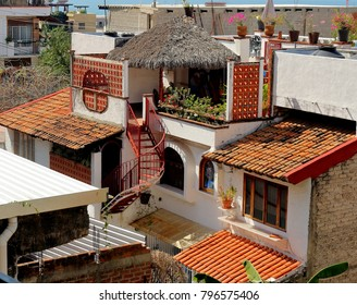 Puerto Vallarta, Jalisco/Mexico - January 15, 2018:  Mexican architecture with winding staircase villa with view of the ocean