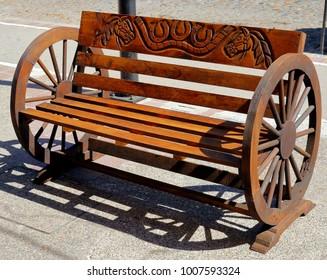 Puerto Vallarta, Jalisco/Mexico - January 19, 2018:  Wooden wheel bench seat with engraving