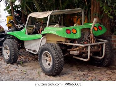 Puerto Vallarta, Jalisco/Mexico, January 9, 2018:  Antique green Dune Buggy parked on cobblestone street