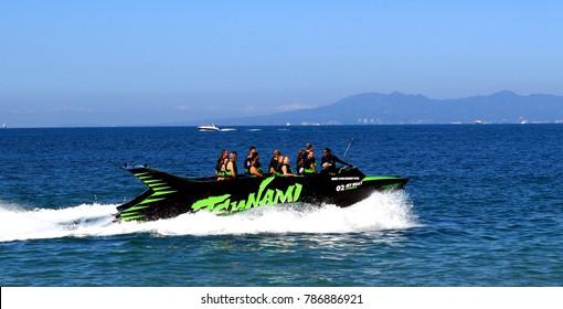 Puerto Vallarta Malecon Boardwalk, Jalisco/Mexico - January 4, 2018:   Speedboat fun