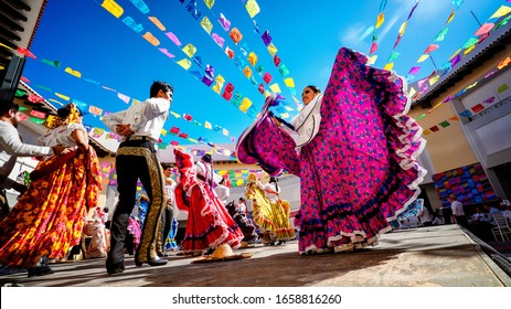 Puerto Vallarta, Mexico - January 28th 2020 - Photo of folklore dancers dancing in a beautiful traditional dress representing mexican culture.