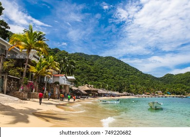 PUERTO VALLARTA, MEXICO - SEPTEMBER 10, 2015: Unidentified people at Playa Las Animas in Mexico. It is a beautiful beach in the southern zone of Puerto Vallarta.