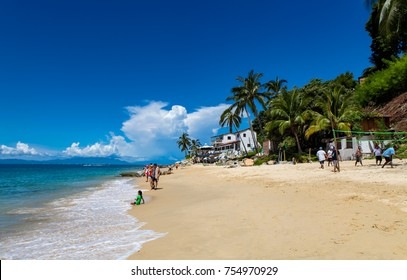 PUERTO VALLARTA, MEXICO - SEPTEMBER 10, 2015: Unidentified people at Playa Las Animas in Mexico. It is a beach in the southern zone of Puerto Vallarta.