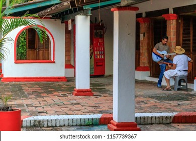 Puerto Vallarta/Mexico 12/14/2016 Isla Cuale Fine Arts Center with shot of 2 mexican men playing guitar in hacienda jungle setting.