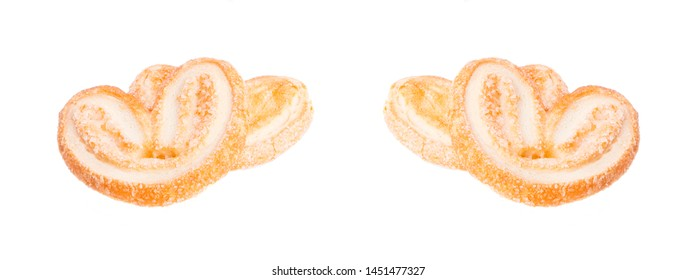 puff ears on a white background. baking puff pastry with the Russian name puff ears. fresh heart-shaped puff pastry