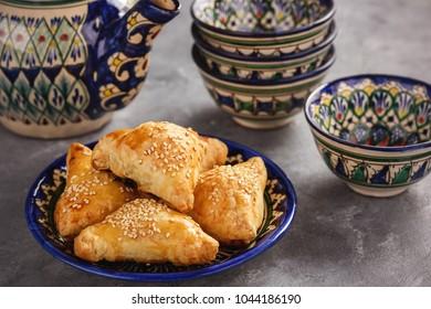 Puff pastries with chicken meat, samosa, oriental uzbek cuisine.
