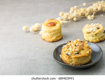 puff pastry with allmond and rasin on table