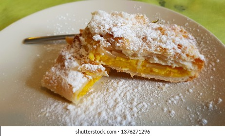 Puff pastry with cream and apples. Italian cuisine