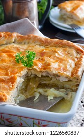 Puff pastry pie with chicken, potatoes and onions, qubit pie, selective focus