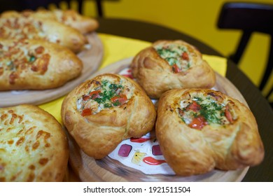 Puff pastry pies with spinach and cheese. vegetarian street food