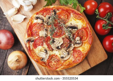 Puff pastry pizza margherita with cheese and tomato
