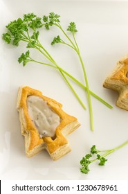 Puff pastry vol-au-vents shaped like a christmas tree and filled with mushroom ragout
