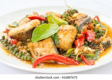Puff savory fish kang put black pepper on dish, Thai food, Thai traditional.