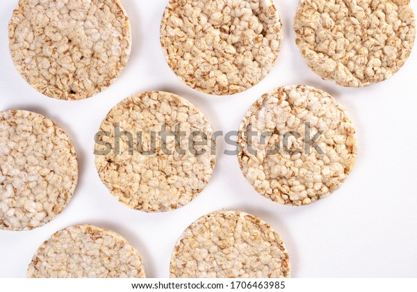 Puffed rice cakes on white background. Flat lay, top view. Rice waffle. copy space