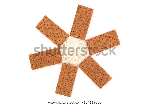 Puffed rice snack and grain crisp bread. White background.