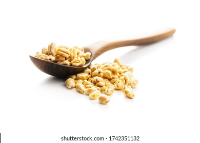Puffed wheat covered with honey in wooden spoon isolated on white background.