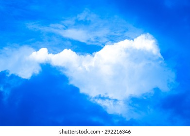 Puffy clouds in a blue mid-summer sky