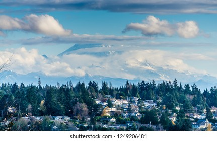 Puffy clouds cover Mount Rainier in Washington State.