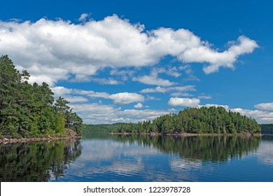 Puffy Clouds in Summer on Cache Bay in the North Woods of Quetico Provincial Park in Ontario, Canada