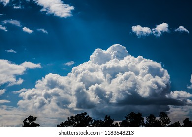 Puffy Clouds and Sun Rays
