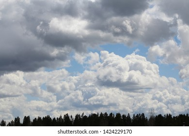 puffy white clouds over montana