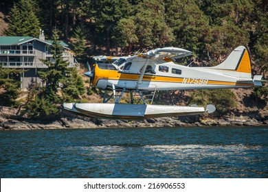 PUGET SOUND, WASHINGTON - AUGUST 4, 2014: A commercial seaplane lands at Orcas Island in Puget Sound.