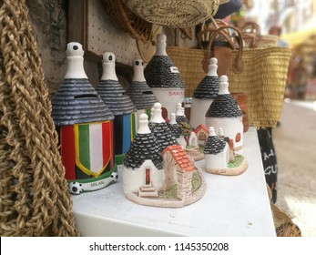 Puglia,Italy: Typical Traditional Building Trulli reproduction for Sale in a Street Shop Market. Souvenir South Italy, Bari.
