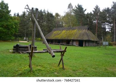 PUHALEPA PARISH HIIUMAA ESTONIA 09 19 2015: Old cottage-cum threshing barnon island of Hiimaa, Estonia.The old medieval village and huts
