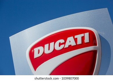 Puilboreau, France - August 7, 2016 : Closeup view of Ducati logo and sign board on blue pylon board outside showroom. Ducati Motor Holding S.p.A. is the motorcycle-manufacturing italian company.