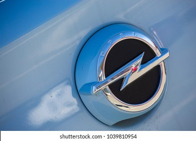 Puilboreau, France - August 7, 2016 : Closeup of opel car logo on blue car with reflection outside showroom at Puilboreau, France. Opel Automobile GmbH is a German automobile manufacturer.