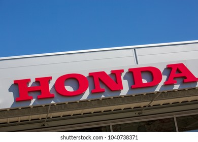 Puilboreau, France - August 7, 2016 : Honda text written in red with logo on exterior roof of distributor at Puilboreau, France. Honda Motor Company,
