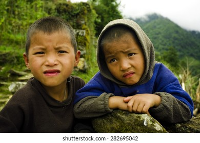 PUIYAN, NEPAL - OCT 1: Unidentified sherpa boys on October 1, 2007 in Puiyan, Everest Region, Nepal. Sherpa are an ethnic group from Nepal, highly regarded as elite mountaineers.
