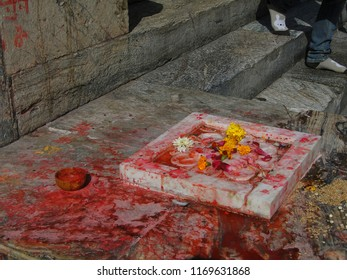 Puja offerings left on steps of in Hindu temple in Udaipur in Rajasthan,  Udaipur, India