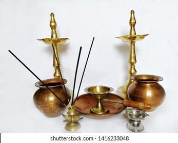 Puja stuff or puja thali with white background includig kalash agarbatti diya dhup samai agarbatti holder