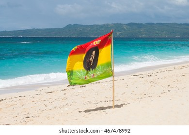 PUKA BEACH, BORACAY ISLAND, PHILIPPINES FEBRUARY 7 2015: Rastafarian flag Bob Marley is the sign for sailboats