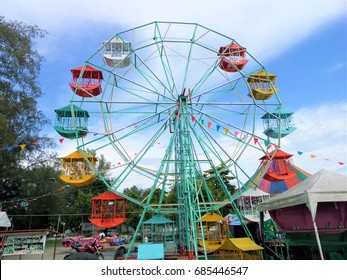PUKED,THAILAND - JULY 14 :Ferris wheel in the park  on July 14 , 2017 in Puked Thailand.  It is a popular market for tourists.